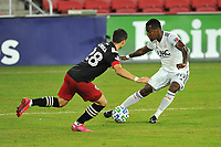 WASHINGTON, DC - SEPTEMBER 27: Cristian Penilla #70 of New England Revolution battles for the ball with Joseph Mora #28 of D.C. United during a game between New England Revolution and D.C. United at Audi Field on September 27, 2020 in Washington, DC.