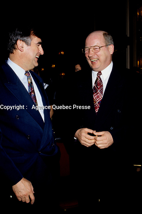 """Montreal (Qc) CANADA - File Photo - May 1996 -<br /> <br /> Lucien Bouchard,  Leader Parti Quebecois (from Jan 29, 1996 to March 2, 2001). seen in a May 1996 file photo with Michel Gauthier, who replaced Bouchard as Bloc Quebecois Leader<br /> <br /> After the Yes side lost the 1995 referendum, Parizeau resigned as Quebec premier. Bouchard resigned his seat in Parliament in 1996, and became the leader of the Parti QuÈbÈcois and premier of Quebec.<br /> <br /> On the matter of sovereignty, while in office, he stated that no new referendum would be held, at least for the time being. A main concern of the Bouchard government, considered part of the necessary conditions gagnantes (""""winning conditions"""" for the feasibility of a new referendum on sovereignty), was economic recovery through the achievement of """"zero deficit"""". Long-term Keynesian policies resulting from the """"Quebec model"""", developed by both PQ governments in the past and the previous Liberal government had left a substantial deficit in the provincial budget.<br /> <br /> Bouchard retired from politics in 2001, and was replaced as Quebec premier by Bernard Landry."""