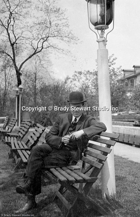 Highland Park: Brady Stewart taking a break from a stroll through Highland Park with Sarah Stewart.  During this time, Brady Stewart lived at 5801 Wellesley Avenue in Highland Park not far from the park entrance.