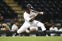 Bradenton Marauders outfielder Raul Fortunato (35) looks to bunt in the rain during a game against the Jupiter Hammerheads on April 17, 2014 at McKechnie Field in Bradenton, Florida.  Bradenton defeated Jupiter 2-1.  (Mike Janes/Four Seam Images)