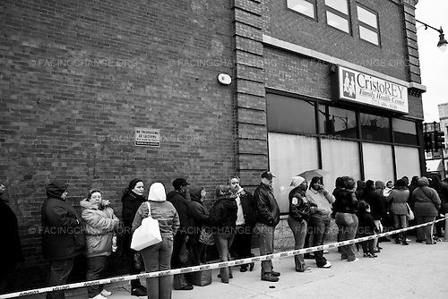 Chicago , Illinois <br /> USA<br /> May 2009<br /> <br /> People wait in line for applications to get on a waiting list for a project-based voucher program through Bickerdike, a community development organization. In 2009 President Barack Obama allocated $13.6 billion to the U.S. Department of Housing and Urban Development for affordable housing and community development.