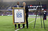 ORLANDO, FL - NOVEMBER 15: DaMarcus Beasley retired USMNT player being honored from US Soccer's Carlos Cordeiro during a game between Canada and USMNT at Exploria Stadium on November 15, 2019 in Orlando, Florida.