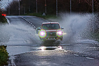 2018 12 07 Car travels through flood in Pyle, Wales, UK