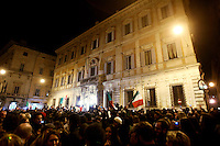 Manifestanti festeggiano le dimissioni del Presidente del Consiglio Silvio Berlusconi, davanti a Palazzo Grazioli, Roma, 12 novembre 2011..People gather to celebrate outside the residence of the Italian Premier Silvio Berlusconi, after he resigned, in Rome, 12 november 2011..UPDATE IMAGES PRESS/Riccardo De Luca