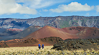Two male hikers with backpacks inside the crater in HALEAKALA NATIONAL PARK on Maui in Hawaii USA