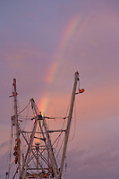 Commercial Fishing Trawler Rigging with Rainbow at Sunset