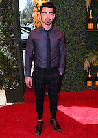 PACIFIC PALISADES, CA, USA - OCTOBER 11: Nick Jonas arrives at the 5th Annual Veuve Clicquot Polo Classic held at Will Rogers State Historic Park on October 11, 2014 in Pacific Palisades, California, United States. (Photo by Xavier Collin/Celebrity Monitor)