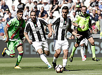 Calcio, Serie A: Juventus vs Crotone. Torino, Juventus Stadium, 21 maggio 2017.<br /> Juventus' Paulo Dybala, foreground, in action during the Italian Serie A football match between Juventus and Crotone at Turin's Juventus Stadium, 21 May 2017. Juventus defeated Crotone 3-0 to win the sixth consecutive Scudetto.<br /> UPDATE IMAGES PRESS/Isabella Bonotto