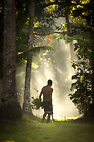 Man with Machete in the forest, Tufi, Cape Nelson, Oro Province, Papua New Guinea