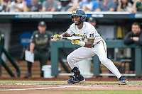 Michigan Wolverines outfielder Christian Bullock (5) squares to bunt against the Vanderbilt Commodores during Game 2 of the NCAA College World Series Finals on June 25, 2019 at TD Ameritrade Park in Omaha, Nebraska. Vanderbilt defeated Michigan 4-1. (Andrew Woolley/Four Seam Images)