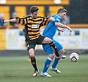 Alloa's Kevin Cawley and Queen of the South's Kevin Dzierzawski challenge for the ball.