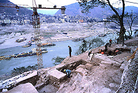 An archeologist and workers excavate the Zhang Fei temple in Yunyang, which has been taken apart and moved several kilometers upstream along the Yangtze River in China..26-FEB-03