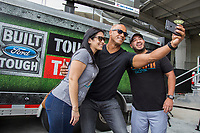 Former NFL player, Jason Taylor takes a selfie with fans at the Built Ford Tough Toughest Tailgate at Hard Rock Stadium on November 6, 2016 (Jesus Aranguren/AP Images for Ford)