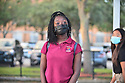 PEMBROKE PINES, FLORIDA - AUGUST 18: 14 years High school student Jayden, arrives for the first day of classes wearing a face mask at Pembroke Pines Charter High a Broward County public school in Pembroke Pines, Florida, U.S., on Wednesday, Aug. 18, 2021.  Florida State Board of Education said it would force defiant school districts to comply with Republican Governor Ron DeSantis executive order forbidding them from mandating students wear masks as a way to slow a surge in Covid-19 cases.  ( Photo by Johnny Louis / jlnphotography.com )