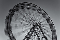 The colorfully illuminated Gentle Giant Ferris Wheel spins against the twilight sky during the New Jersey State Fair on August 8, 2012 at the Sussex County Fairgrounds, Augusta, New Jersey.