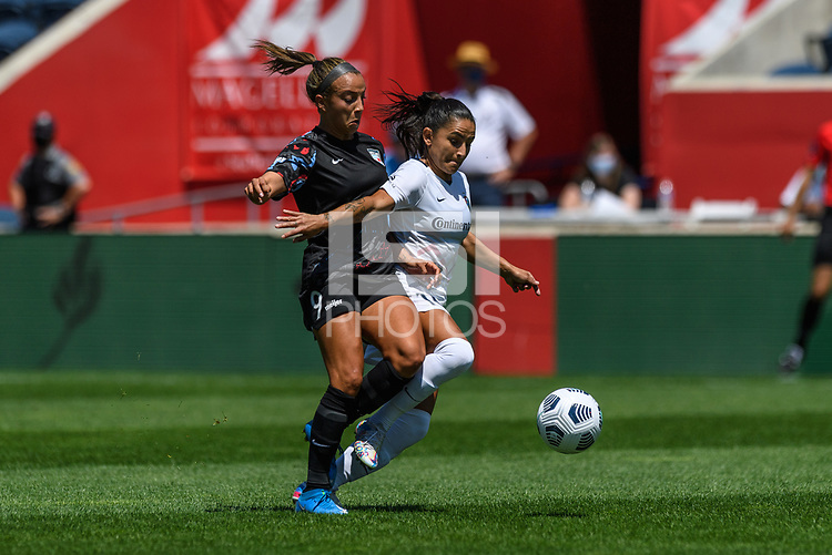 BRIDGEVIEW, IL - JUNE 5: Mallory Pugh #9 of the Chicago Red Starsand Debinha #10 of the North Carolina Courage battle for the ball during a game between North Carolina Courage and Chicago Red Stars at SeatGeek Stadium on June 5, 2021 in Bridgeview, Illinois.