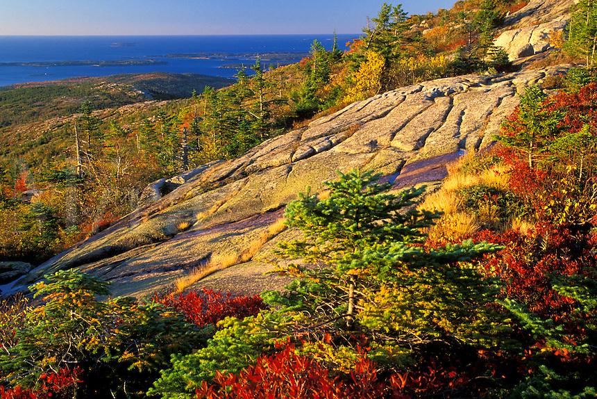 The sun rises over the Atlantic Ocean from Cadillac Mountain, Acadia National Park, Maine