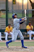 Michael Ahmed #21 of the AZL Dodgers bats against the AZL Athletics at Phoenix Municipal Stadium on July 10, 2013 in Phoenix, Arizona. AZL Athletics defeated the AZL Dodgers, 7-1. (Larry Goren/Four Seam Images)