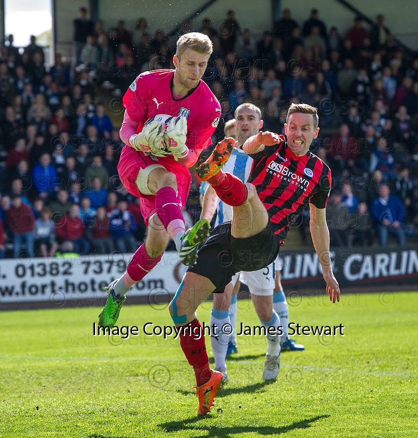 St Johnstone's Steven MacLean goes in high on Dundee keeper Scott Bain.