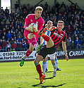 St Johnstone's Steven MacLean goes in high on Dundee keeper Scott Bain.