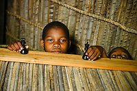 MADAGASCAR, Mananjary, tribe ANTAMBAHOAKA, fady, according to the rules of their ancestors twin children are a taboo and not accepted in the society, the orphanage TSARAZAZA Center takes care for abandoned twins  / MADAGASKAR, Zwillinge sind ein Fady oder Tabu beim Stamm der ANTAMBAHOAKA in der Region Mananjary, Waisenhaus TSARAZAZA Center betreut Zwillingskinder die ausgesetzt oder von ihren Eltern abgegeben wurden, Zwilling PIERRE