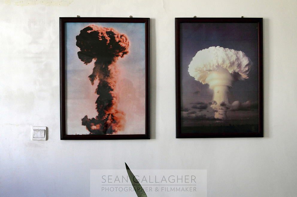 CHINA. Pictures depicting atomic bomb explosions in the tourist reception area of the underground command center in Xihai Township, or 'Atomic City'. It was the place where China's first atomic bomb was made and tested, on the Qinghai-Tibet Plateau in western China. 2010