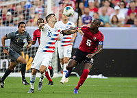 CLEVELAND, OH - JUNE 22: Christian Pulisic #10 contests the ball with Daneil Cyrus #5 during a game between the United States and Trinidad & Tobago at FirstEnergy Stadium on June 22, 2019 in Cleveland, Ohio.