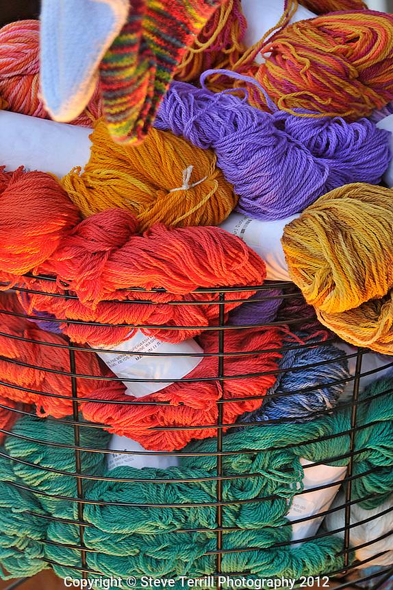 Evening light through window on basket of yarn bundles in Portland, Oregon