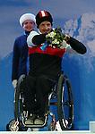 Josh Dueck, Sochi 2014 - Para Alpine Skiing // Para-ski alpin.<br /> Josh Dueck celebrates his silver medal in the men's sitting downhill event // Josh Dueck célèbre sa médaille d'argent dans l'épreuve masculine de descente assise. 08/03/2014.