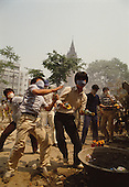 """Seoul, South Korea.June 11, 1987..Students battle government riot police at Myongdong Cathedral, a landmark that became a strong hold for the student opposition...After two decades of building an economic miracle, in the summer of 1987 tens of thousands of frustrated South Korean students took to the streets demanding democratic reform. """"People Power"""" Korean-style saw Koreans from all social spectrums join in the protests...With the Olympics to be held in South Korea in 1988, President Chun Doo Hwan decided on no political reforms and to choose the ruling party chairman, Roh Tae Woo, as his heir. The protests multiplied and after 3 weeks Chun conceded releasing oppositionist Kim Dae Jung from his 55th house arrest and shaking hands with opposition leader Kim Young Sam. Days later he endorsed presidential elections and an amnesty for nearly 3,000 political prisoners. It marked the first genuine initiative of democratic reform in South Korea and the people had their victory."""