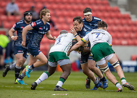 21st March 2021; AJ Bell Stadium, Salford, Lancashire, England; English Premiership Rugby, Sale Sharks versus London Irish; Coenie Oosthuizen of Sale Sharks is tackled by Lovejoy Chawatama and Ben Donnell of London Irish