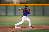 AZL Cubs 1 second baseman Yonathan Perlaza (12) throws to first base to try to complete a double play during an Arizona League game against the AZL Padres 1 at Sloan Park on July 5, 2018 in Mesa, Arizona. The AZL Cubs 1 defeated the AZL Padres 1 3-1. (Zachary Lucy/Four Seam Images)
