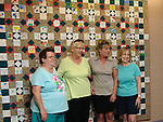 WASHINGTON, CT - 28 August 2012-082812EC08--     Country Life use.  Gunn Library in Washington is observing the Civil War with a quilt. Children decorated the squares with a fabric marker while senior citizens stitched them into a quilt.  The sewers from L to R: Betty Cheney of New Preston, Brighid Davidson of New Preston, Pam Collins of Washington and Sharon Morrissey of Washington.  Erin Covey Republican American.