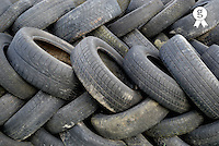Pile of used car tires (Licence this image exclusively with Getty: http://www.gettyimages.com/detail/74583283 )