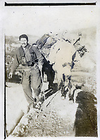 BNPS.co.uk (01202 558833)<br /> Pic: HannBooks/BNPS<br /> <br /> PICTURED: A partisan guide with a mule carrying weapons and armour.<br /> <br /> Remarkable photos taken deep behind enemy lines by an SAS unit during a daring wartime operation have come to light on the 75th anniversary of the mission. <br />  <br /> The little-known Operation Galia on the 27th December 1944 involved just 33 SAS men hoodwinking the Nazis and their fascist allies into thinking a much greater force had landed behind them in Italy in December 1944.<br />  <br /> Adolf Hitler's forces had just launched a major surprise offensive in the Ardennes Forest in Belgium that became known as the Battle of the Bulge.<br /> <br /> Robert Hann, whose late father was SAS Paratrooper Stanley Hann, retraced his father's wartime experiences and part of his [father's] epic 80 mile long escape route through the Apennine mountains which the men took, to help him write the book 'SAS Operation Galia.'