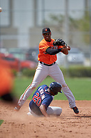 Baltimore Orioles Sharlon Schoop (41) throws to first as Robert Molina (20) slides into second base during a minor league Spring Training game against the Minnesota Twins on March 16, 2016 at CenturyLink Sports Complex in Fort Myers, Florida.  (Mike Janes/Four Seam Images)