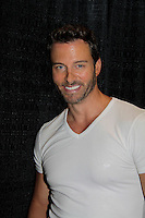 "Days of Our Lives Eric Martsolf ""Brady Black"" appears at the 12th Annual Comcast Women's Expo on September 7 (also 6th), 2014 at the Connecticut Convention Center, Hartford, CT. He signed photos, posed with fans, walked the runway with models from Kathy Faber Designs Fashion Show, and broke some boards at Villari's Martial Arts Centers booth with Maggie and Ryan Farley.  (Photo by Sue Coflin/Max Photos)"