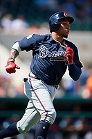 Atlanta Braves first baseman Johan Camargo (17) runs to first base during a Grapefruit League Spring Training game against the Detroit Tigers on March 2, 2019 at Publix Field at Joker Marchant Stadium in Lakeland, Florida.  Tigers defeated the Braves 7-4.  (Mike Janes/Four Seam Images)
