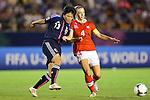 (L to R) Ayaka Michigami (JPN), Carina Gerber (SUI), .AUGUST 26, 2012 - Football / Soccer : .FIFA U-20 Women's World Cup Japan 2012, Group A .match between Japan 4-0 Switzerland .at National Stadium, Tokyo, Japan. .(Photo by Daiju Kitamura/AFLO SPORT)