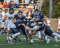 Har-Ber's Malichi Cramer is tackled by the Greenwood defense in the first half of Friday's game at Greenwood.