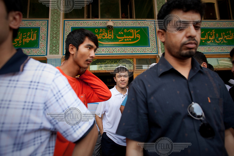 Uighur men leave the Yang Hang Mosque after Friday prayers in Urumqi. Due to the recent ethnic violence, Chinese authorities had tried to stop Friday prayers going ahead but at the last minute the doors to the mosque were opened.