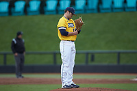 UNCG Spartans starting pitcher Jeremiah Triplett (34) checks his wristband for the pitch call during the game against the San Diego State Aztecs at Springs Brooks Stadium on February 16, 2020 in Conway, South Carolina. The Spartans defeated the Aztecs 11-4.  (Brian Westerholt/Four Seam Images)