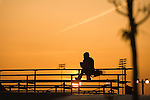 Silhouette of a person on the bleachers at Mobash Skate park on a summer evening in Missoula, Montana