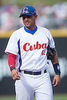 Yordan Manduley Escalona (42) of the Cuban National Team prior to the start of the game against the US Collegiate National Team at BB&T BallPark on July 4, 2015 in Charlotte, North Carolina.  The United State Collegiate National Team defeated the Cuban National Team 11-1.  (Brian Westerholt/Four Seam Images)