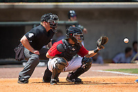 Birmingham Barons catcher Adrian Nieto (6) prepares to receive a pitch as home plate umpire Garrett Patterson looks on during the game against the Tennessee Smokies at Regions Field on May 4, 2015 in Birmingham, Alabama.  The Barons defeated the Smokies 4-3 in 13 innings. (Brian Westerholt/Four Seam Images)