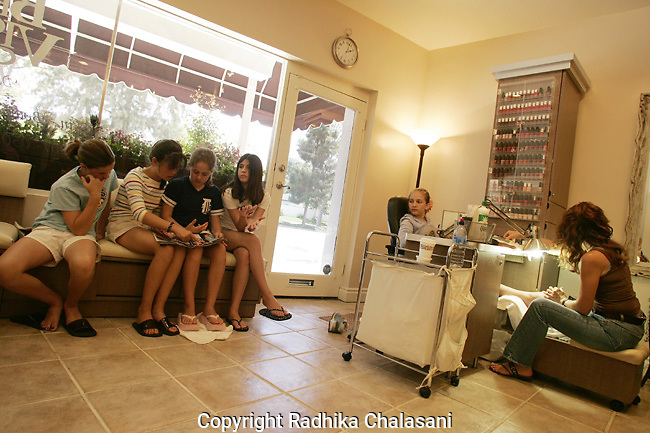 STUDIO CITY, CA-JUNE 10: Anne-Sophie Elkus (12) enjoys a manicure at the Belle Visage Day Spa while her friends wait their turn during a spa party June 10,2004 in Studio City. An increasing number of spas in the U.S. are providing services for teens and pre-teens (tweens).  American teens are spending nearly 20 billion USD a year on health and beauty products. (Photo by Radhika Chalasani)