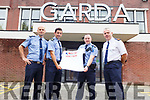 Garda Aidan O'Mahoney and Eoghan Walsh pictured with Sgt Tim O'Keeffe and Supt Dan Keane at the Tralee Garda station on Friday as they launch their Walk the Camino in Portugal which will take place in early September as a fundraiser for Cardiac Risk in the Young (CRY).