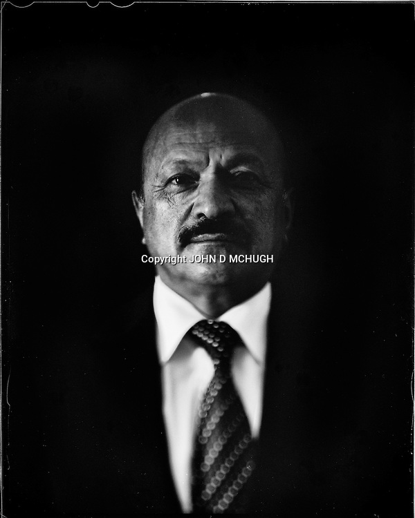 """Muhammad Yunus Nawandish, the Mayor of Kabul, is seen in his office, 25 August 2012. This portrait was shot on a 5x4 Linhof Technika IV, circa 1959, and a Schneider Kreuznach 270mm lens, circa 1952, with front tilt, and is part of a series entitled """"Putting an Afghan face on the war."""" (John D McHugh)"""
