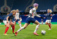 LE HAVRE, FRANCE - APRIL 13: Megan Rapinoe #15 of the USWNT dribbles during a game between France and USWNT at Stade Oceane on April 13, 2021 in Le Havre, France.