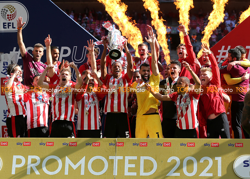 Ethan Pinnock lifts the Championship Trophy aloft as Brentford celebrate promotion to the Premier League during Brentford vs Swansea City, Sky Bet EFL Championship Play-Off Final Football at Wembley Stadium on 29th May 2021